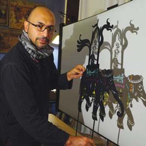 "Hamid Rahmanian is shown with a puppet from ""Feathers of Fire,"" which opens on Oct. 20 at The Wallis. (photo courtesy of The Wallis)"