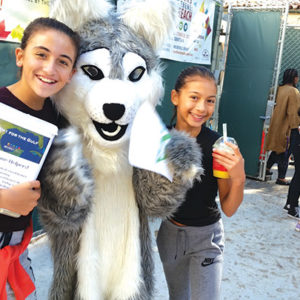 """Horace Mann students Michaella Moawad and Makena Pajar collected hurricane relief donations as part of the school district's """"BH1 for the Gulf"""" effort. (photo courtesy of the Beverly Hills Unified School District)"""