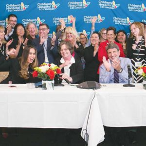 CHLA President and CEO Paul S. Viviano (seated, center) celebrates with staff upon hearing the news of the hospital's third consecutive Magnet Recognition. (photo courtesy Children's Hospital Los Angeles)