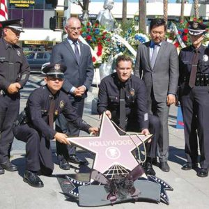 Capt. Cory Palka, center, joined Councilmen Mitch O'Farrell and David Ryu during a ceremony on the Hollywood Walk of Fame. (photo by Edwin Folven)
