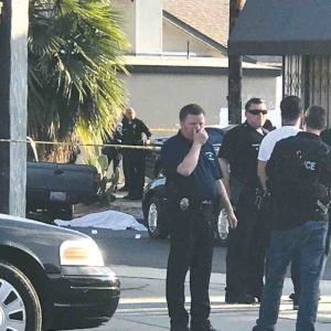 Police cordoned off the area around Melrose and Sierra Bonita avenues after a victim was killed in late August. The murder was one of the recent incidents causing concern in the Melrose Avenue shopping district. (photo by Peter Nichols)