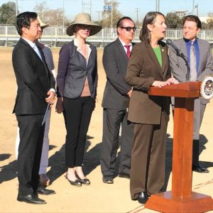 Assemblywoman Laura Friedman (D-Glendale), at the podium, has helped secure funding that could help improve paths for walkers and bikers into Griffith Park. (photo by Luke Harold)