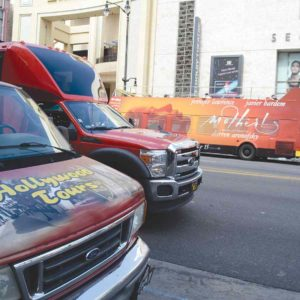 Tour buses are frequently seen on Hollywood Boulevard, taking tourists to see famous landmarks and celebrity homes. (photo by Jaclyn Cosgrove)