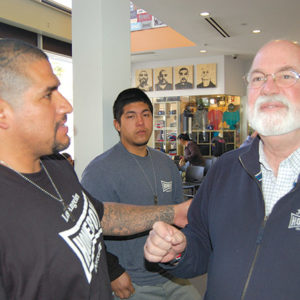 Father Greg Boyle (right) will sign copies and discuss his latest book about helping former gang members turn their lives around at Homeboy Industries. (photo by Edwin Folven)