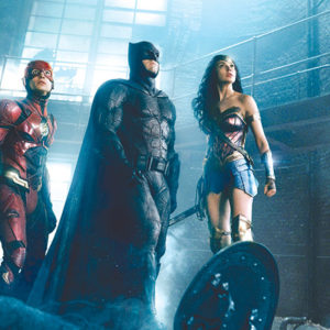 "Flash (Ezra Miller), Batman (Ben Affleck) and Wonder Woman (Gal Gadot) come together in the new ""Justice League"" film. (photo courtesy of Warner Bros. Pictures)"
