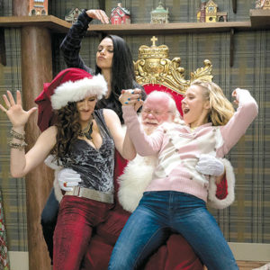 "Mila Kunis as Amy, Kristen Bell as Kiki and Kathryn Hahn as Carla have some fun with Santa in ""A Bad Moms Christmas."" (photo courtesy of STX Entertainment)"