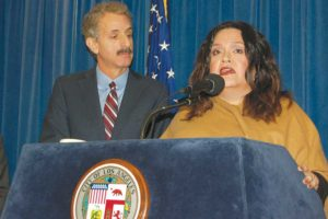Mariana Marroquin, program manager for the Los Angeles LGBT Center's Anti-Violence Project, outlined services for LGBT victims of hate crimes and was joined by Los Angeles City Mike Feuer, who called for more reporting of incidents. (photo by Edwin Folven)
