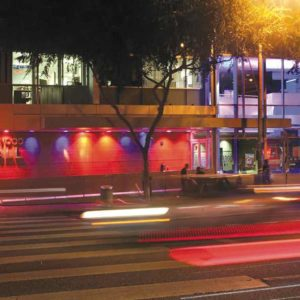 West Hollywood CityHall is  illuminated in blue, pink and white lights – the colors of the transgender flag. (photo by Joshua Barash, courtesy of the city of West Hollywood)