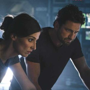 Jake Lawson (Gerard Butler) and Ute Fassbinder (Alexandra Maria Lara) try to figure out who is intentionally causing catastrophic weather events. (photo courtesy of Warner Bros. Pictures)