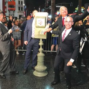 Local leaders led a countdown before pulling down a level to light up Hollywood Boulevard. (photo by Luke Harold)