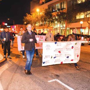 Participants in a West Hollywood candlelight vigil will walk to the library to continue their World AIDS Day remembrance, as they did in 2016. (photo courtesy of the city of West Hollywood)