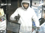 Gunman who robbed smoke shop wanted