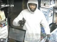 Gunman who robbed smoke shop wanted