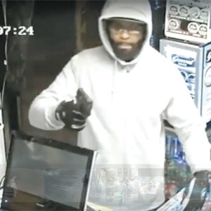 A security camera video distributed by police shows the armed suspect during the robbery at the smoke shop. (photo courtesy of the LAPD)