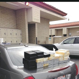 Sheriff's department authorities displayed drugs that were seized as part of an effort to combat heroin and opioid trafficking. (photo courtesy of the LASD)
