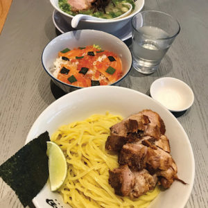 Enjoying dipping ramen and rice bowls topped with pork or salmon at The Tsujita. (photo by Jill Weinlein)