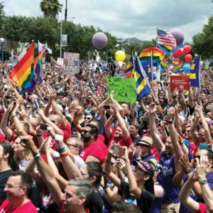 Tens of thousands of demonstrators came together in June during the #ResistMarch, which temporarily replaced the annual LA Pride Festival held in West Hollywood. (photo by Jon Viscott)