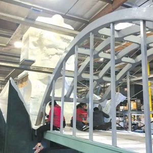 """Above: AIDS Healthcare Foundation's """"Keeping the Promise"""" float is being decorated in the days leading up to the Rose Parade. The float pays tribute to Dr. Martin Luther King Jr. and features an artwork depicting the civil rights leader. (photos by Ged Kenslea/courtesy of AHF)"""