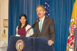 Los Angeles City Attorney Mike Feuer outlined his lawsuit against Uber Technologies over a data breach in 2016. He was joined by Marissa Roy, a fellow in the city attorney's office. (photo by Edwin Folven)