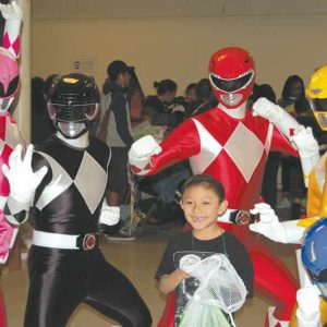 The Mighty Morphin Power Rangers made a surprise appearance at the Saban Community Clinic's annual holiday party, much to the delight of children who attended the event. (photo by Edwin Folven)