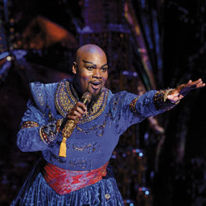 """Michael James Scott, as the Genie, sings """"Friend Like Me"""" in a 10-plus minute performance, seemingly never stopping to take a breath. He brought the audience to their feet on opening night. (photo by Deen van Meer)"""