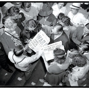 People looked at newspapers in Washington, D.C. on Sept. 1, 1939, the day the invasion of Poland began. (photo courtesy of American Cinematheque)