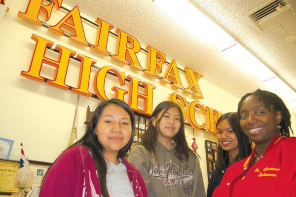 Fairfax High School science teacher Fréda Antoine (right) congratulated students Valerie Castro, Tiffany Pamilar and Marianne Gutierrez on being selected as finalists in Metro' tunnel boring machine naming contest. (photo by Edwin Folven)
