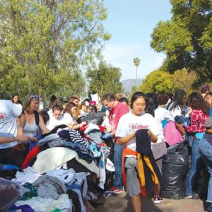 More than 1,000 volunteers sorted clothing to be donated by Big Sunday during an MLK Day of Service event on Monday. (photo by Crystal Duan)