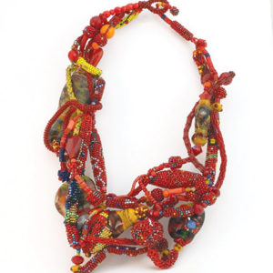 "Joyce J. Scott's ""Red Electricity"" necklace displays her elaborate weaving and beading techniques. (photo courtesy of Craft in America)"