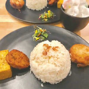 Order the rijstaffel to receive some of Rinjani's most popular items on one plate. (photo by Jill Weinlein)