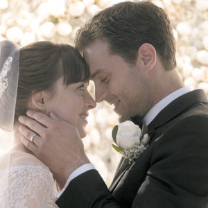 """Jamie Dornan as Christian Grey and Dakota Johnson as Anastasia Steele are married in """"Fifty Shades Freed,"""" the latest film in the trilogy by E.L. James. (photo courtesy of Universal Pictures)"""