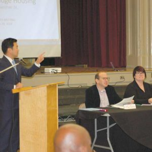 Councilman David Ryu, 4th District, led a meeting Tuesday on a bridge housing facility proposed in Hollywood for women and children experiencing homelessness. The meeting included a panel moderated by Marc Purchin (seated, left); Meg Barclay, the city's homeless coordinator in the chief administrative office; Rebecca Abano, of the city's Bureau of Engineering; and Jeff Proctor, with the Los Angeles Homeless Services Authority. (photo by Edwin Folven)