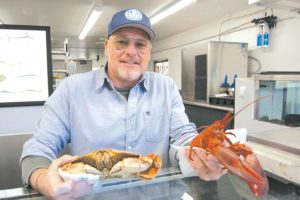 Stephane Strouk, owner of Monsieur Marcel Gourmet Market and Bistro at the Original Farmers Market, is offering top quality fresh seafood delivered daily at his new Monsieur Marcel Seafood Market. (photo by EdwinFolven)