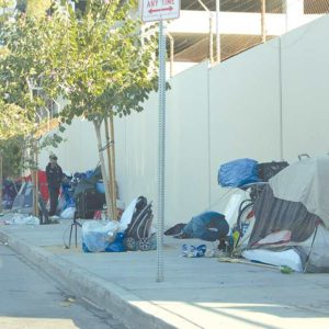 Homeless individuals frequently stay near the edge of West Hollywood, including along Poinsettia Place, just south of the city's border with Los Angeles along Romaine Street. (photo by Edwin Folven)
