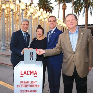 "LACMA's Michael Govan (left) joined Nancy Rubins, an artist and widow of ""Urban Light"" creater Chris Burden; Los Angeles Mayor Eric Garcetti; and Terry Tamminen, CEO of the Leonardo DiCaprio Foundation, for the sculpture's 10th anniversary celebration. (photo by John Sciulli (c) Museum Associates/LACMA)"