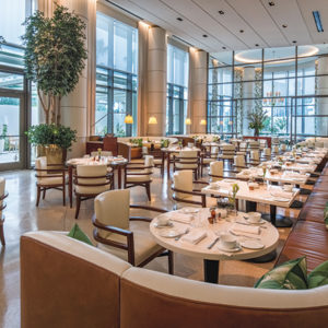 The dining room at Jeans Georges features soft leather banquettes, a lively atmosphere and impeccable cuisine by Executive Chef Steve Benjamin and Chef Jean-Georges Vongerichten. (photos by William Rust, Waldorf Astoria Beverly Hills)