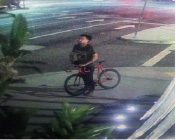 A security camera captured grainy images of the suspect, who was riding a single-speed red bicycle. (photo courtesy of the BHPD)