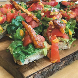 The L.G.B.T toast is visually spectacular made with lettuce, guacamole, tempeh bacon and tomatoes. (photo by Jill Weinlein)