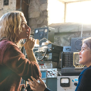 "Evelyn (Emily Blunt) and Regan (Millicent Simmonds) must remain silent to stay safe from monsters in ""A Quiet Place."" (photo courtesy of Paramount Pictures)"