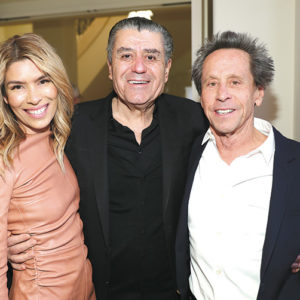 Veronica and Brian Grazer received the World of Children Board of Governors' Award at the ceremony. They were joined by producer Haim Saban (center). (photo by Rich Polk/Getty Images for World of Children)