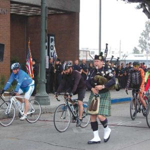 A contingent of 75 officers on bicycles left the LAPD's Hollywood Division on April 24 in the first leg of the Hollywood Memorial Ride. Eight of the cyclists will ride cross-country to honor local law enforcement officers killed in the line of duty during National Police Week activities in Washington, D.C. (photo by Edwin Folven)