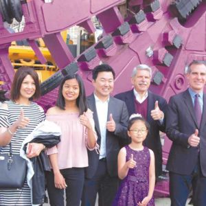 Fairfax High student Marianne Gutierrez (third from left) was joined by family and local civic leaders during a ceremony announcing that she won a contest to name Metro's twin Purple Line Extension tunnel boring machines. Officials also recognized third grader Lauren Park (front), who won the tunnel boring machine art contest. (photo by Edwin Folven)