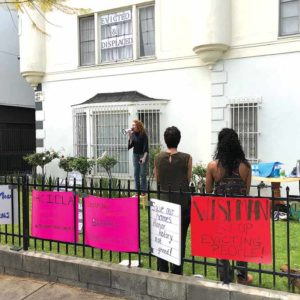 Dee Ann Newkirk led a protest in front of her now-former residence to oppose Ellis Act evictions that have reduced affordable housing. (photo by Luke Harold)