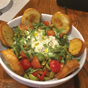 Try one of their delicious salads, like the local burrata with vine ripe tomatoes, Tuscan olives and basil. (photo by Jill Weinlein)