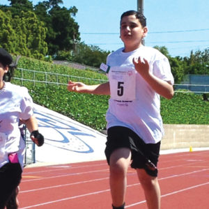 Beverly Hills High School Junior Eddie Elyasof, right, races to the finish line in the 50-yard dash in a previous event. (photo courtesy of the Beverly Hills Unified School District)