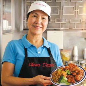 Angie Chang, owner of China Depot, is one of the longtime matriarchs operating businesses at the OriginalFarmers Market. (photo courtesy of the OriginalFarmers Market)