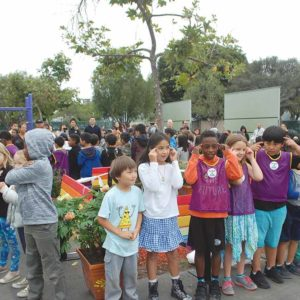 "Second graders at Hancock Park Elementary School sang and danced to ""We are the World"" at the dedication ceremony for the school's friendship benches. (photo by Maura Turcotte)"