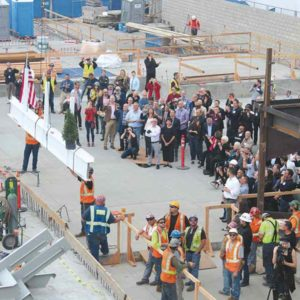 Dozens of people looked on as crews hoisted the final beam into place at the LA LGBT Center's new facility in Hollywood. (photo courtesy of the Los Angeles LGBT Center)
