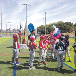 Los Angeles City Councilman David Ryu, 4th District, joined players from the Wilshire Warriors youth baseball league at a dedication for the new baseball diamond and soccer field at Pan Pacific Park. (photo courtesy of the 4th Council District office)