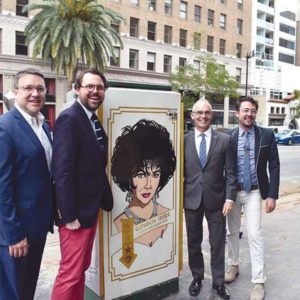 From left to right, Pantages General Manager Jeff Loeb, artist John Casey Harris, Councilmember Mitch O'Farrell, and Hollywood Entertainment District Director of Operations and Hollywood Arts Council Vice Chair Rich Sarian stand with the utility box honoring actress Elizabeth Taylor. (photo by Micaela Cummings)
